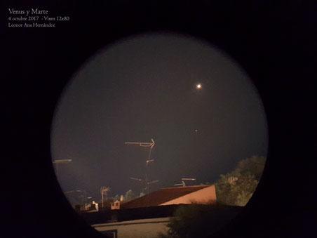 Imagen tomada con teléfono móvil asomado a los prismáticos Vixen 12x80