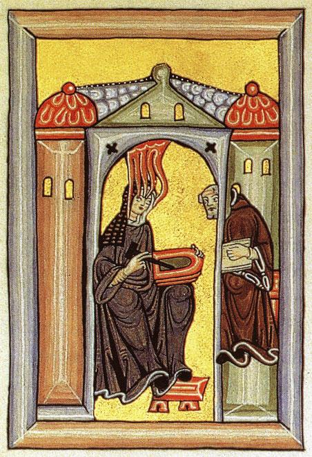Hildegard von Bingen empfängt eine göttliche Inspiration und gibt sie an ihren Schreiber weiter. Miniatur aus dem Rupertsberger Codex des Liber Scivias.