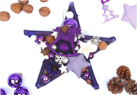 Stern in violett und weiß mit Schaukelpferd
