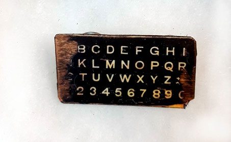 Alphabet board brooch