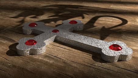 Kreuz mit roten Rubinen