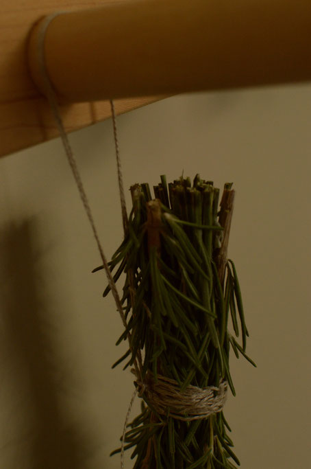 stems bound and looped with linen