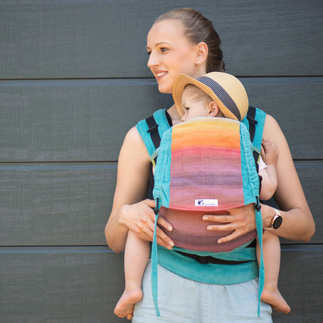Huckepack Half Buckle baby carrier by Huckepack, adjustable back panel, made from wrap fabric, wrap conversion, padded straps to tie, hipbelt with buckle.