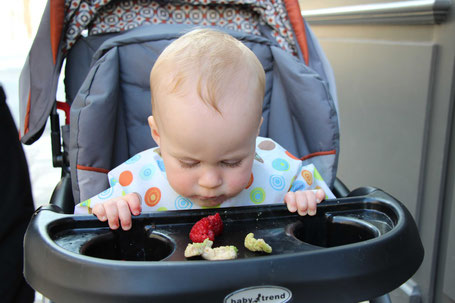 Stroller snack tray used for eating. Travel with baby