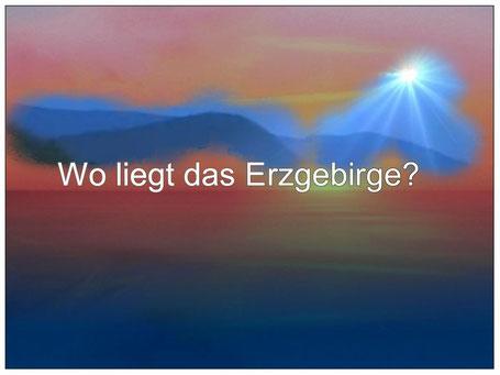 Dieses Bild zeigt in einer Grafik ein Gebirge mit einem hellen Sonnenstrahl. Der Text dazu fragt: Wo liegt das Erzgebirge?