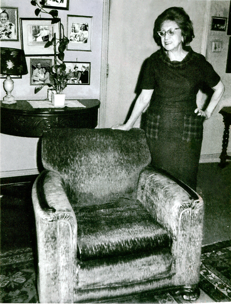 Hilda Fuchs with the arm-chair that Meher Baba sat in during his visit to California.