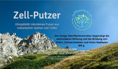 Etikett des Zell-Putzer Produkts blauer Himmel mit Bergen Wald und Wiese