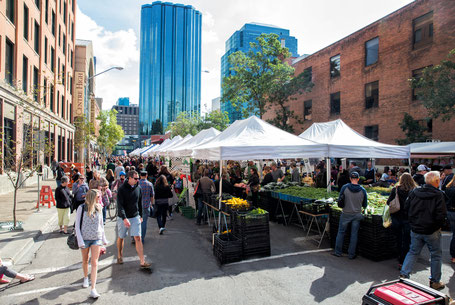 People shopping at a farmer's market in downtown Edmonton