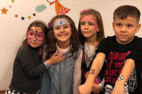Bambini sorridenti con truccabimbi e body painting a Roma