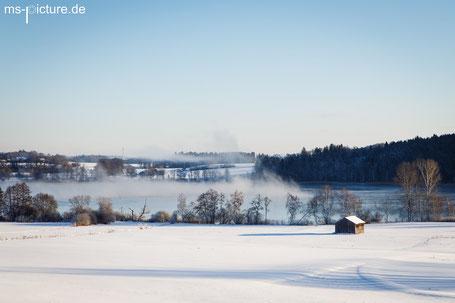 Nebelschwaden über dem Waginger See