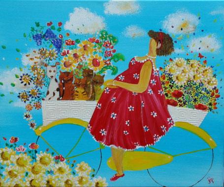 dame op de fiets met katten, een hond en bloemen