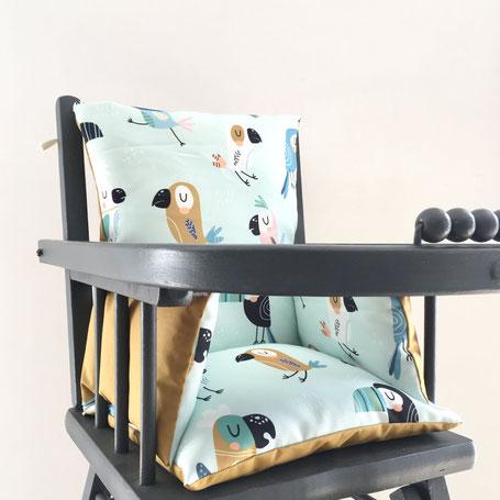 Coussin de chaise haute combelle modèle Toucan en tissu déperlant