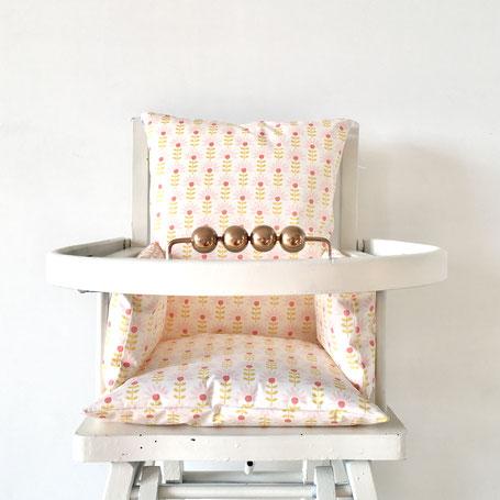 Cette image représente un coussin de chaise haute modèle Bridget pour chaise haute de type Combelle