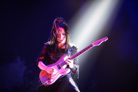 Ohmura performing with Marty Friedman