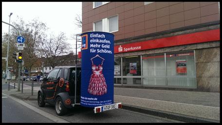 Aldi-süd, Sparkasse,Düsseldorf, Aussenwerbung ; mobile  Werbesäule ; Reklame ; Werbung ; mobile Außenwerbung ; refix GmbH ; advertising ; pillar ; column ; günstig; inovation ; einzigartig ; unique