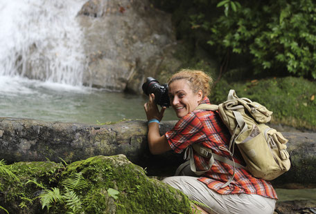 Irina Bruce, co-founder of IRIELAB filming hidden waterfall in Jamaica