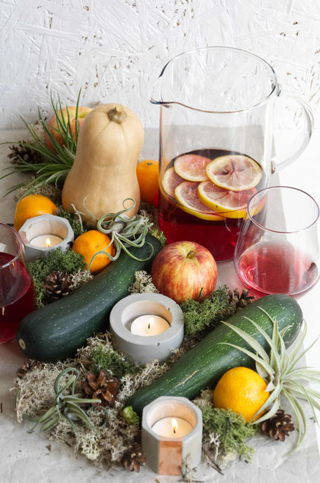 Autumn centrepiece with Air Plants, fresh produce, moss and concrete candle holders By PASiNGA Blog
