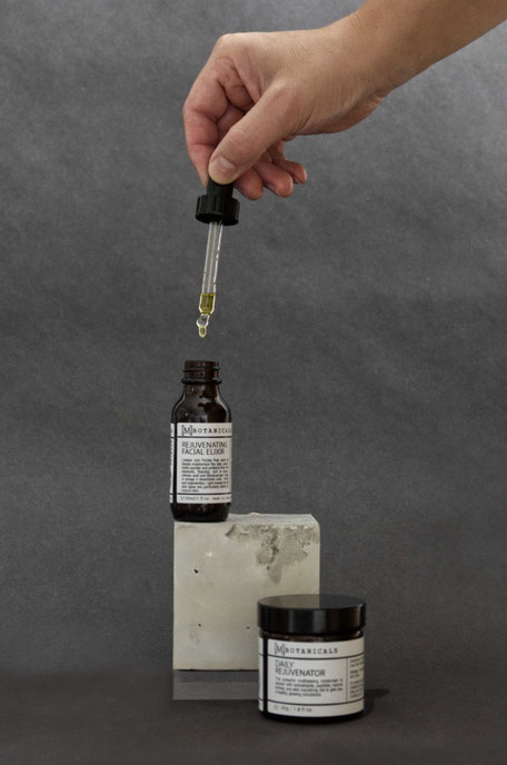 Styled product photography by PASiNGA with concrete cube prop for MBotanicals skincare