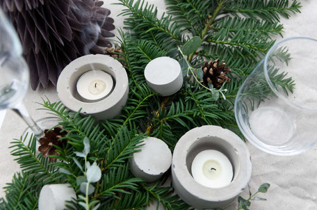 Modern Table Settings For Christmas With Evergreens And Concrete Accents By PASiNGA