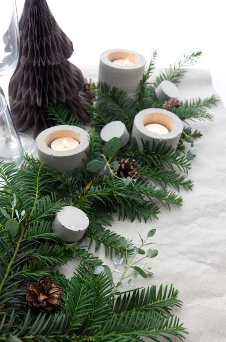 Festive Table Settings For Christmas With Evergreens And Concrete Accents By PASiNGA