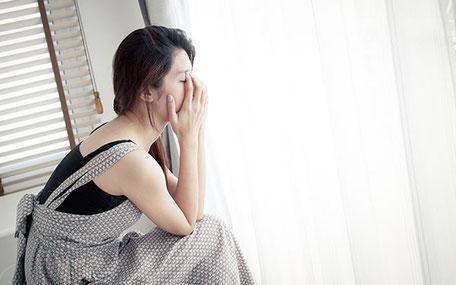 うつ病に悩む女性