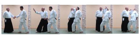 画像② 左半身片手取り 昇氣で呼吸法:左手足腰で目付け(体軸)を確立し、右足腰に軸足交代した陰の魄氣から左手足を進める