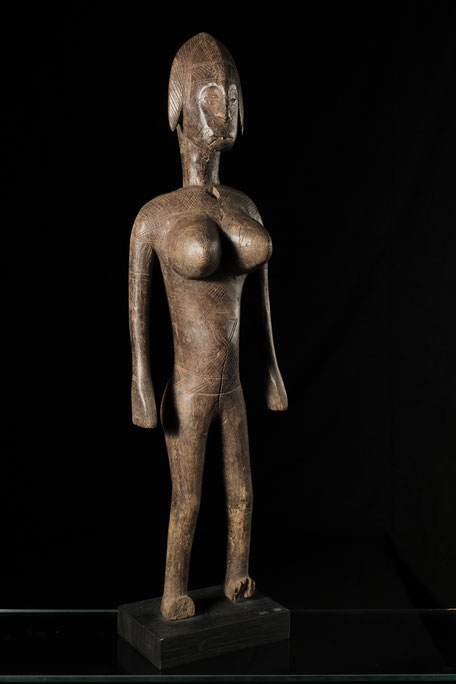 Bambara Figure with shiny patina and scarifications on head and upper body.