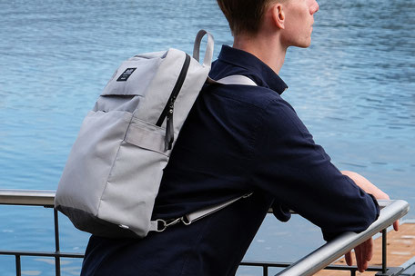 Backpack - Universal Design backpack project - Man with universal backpack on his shoulder watching the lake leaning against a parapet  - wheelchair backpack - inclusive design - backpack - swiss made