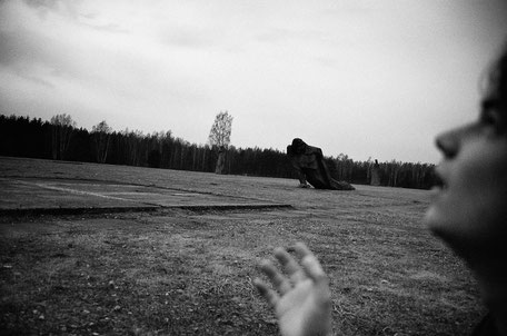 LATVIA / Salaspils / From the book 'Auftakt'. Man looks up in sky on the place of Salaspils concentration camp, 2006