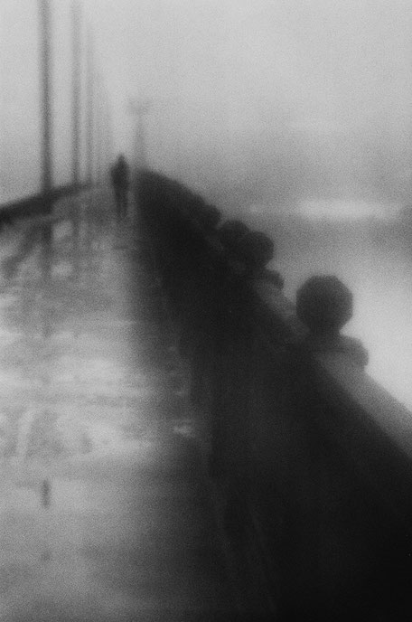 "LATVIA / Riga / From the book ""Auftakt"". Lonely figure at Stone Bridge, 2006"