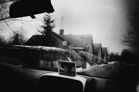 LATVIA / From the book 'Auftakt'. In a car with Sathya Sai Baba portrait, 2009