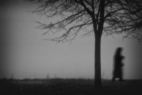 LATVIA / Riga / From the book 'Auftakt'. Silhouette of walker in fog.