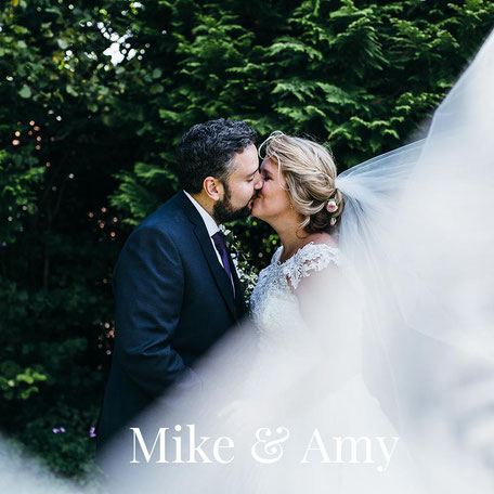 portrait of a bride and groom kissing