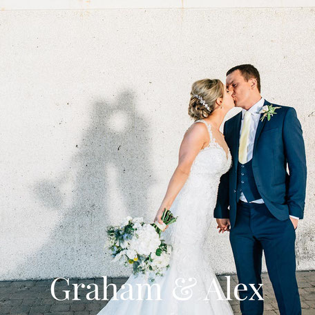 bride and groom kissing whilst their shadow falls onto a wall