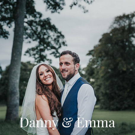 portrait of a bride and groom at meals hall wedding venue