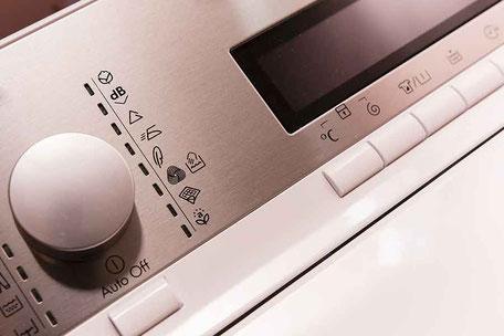 Siebdruck auf Gehaeuse von  Waschmaschinenkonsole