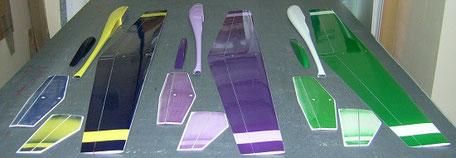 intrados de 3 planeurs coquillajs Aeromod jaune-bleu foncé, violet-violet et blanc-vert