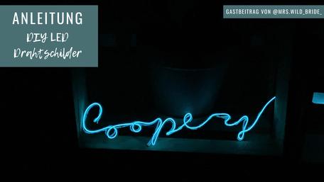 """Ein Drahtschild hat die Form des Schriftzuges für """"Coopery""""."""