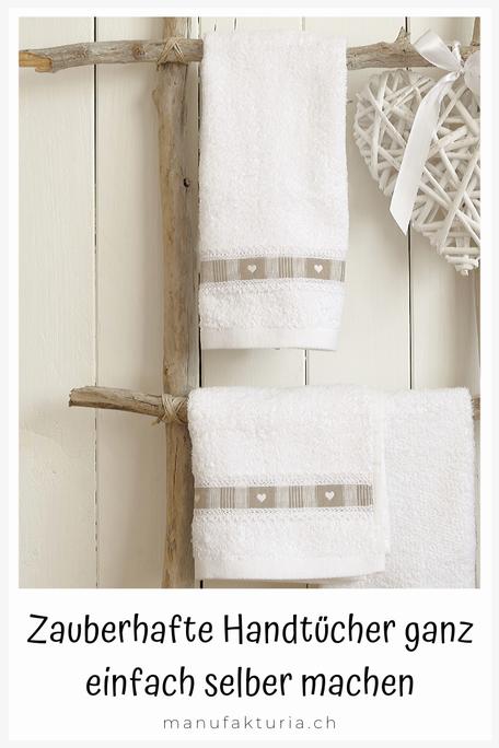 Handarbeit: Leiter mit weissen Handtüchern dekoriert
