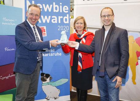 Kulturbürgermeister Dr. Albert Käuflein, Messe Karlsruhe-Chefin Britta Wirtz und Festivalleiter Dr. Oliver Langewitz freuen sich auf der offerta über die neue Kooperation.
