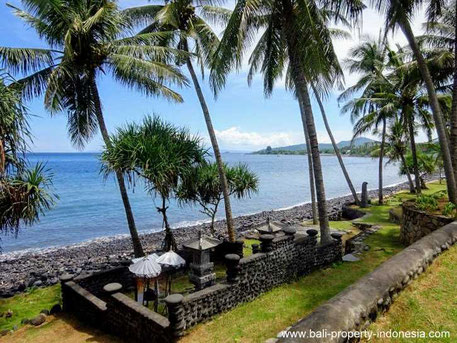 Seraya beachfront land including some bungalows for sale