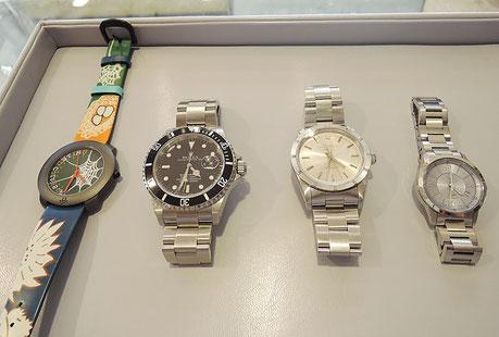 写真の腕時計はロレックスのサブマリーナやエアキング、国産高級時計など