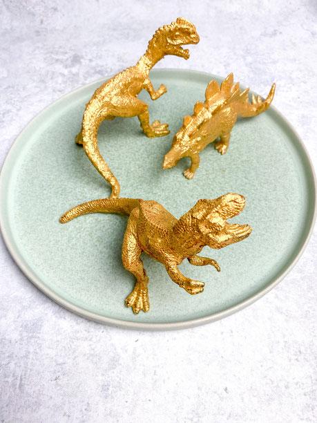 Goldene Dinos als Caketopper