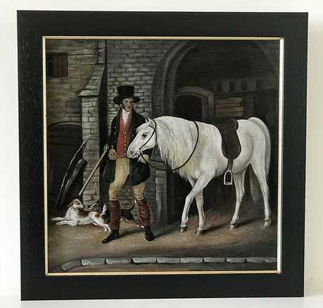 Regency period English provincial scene of a gentleman leading his horse from his stable A well dressed young gentleman in high hat and silk neckcloth or stock, leads his saddled white horse out of the stable with his dogs scampering at his feet.  Date 18