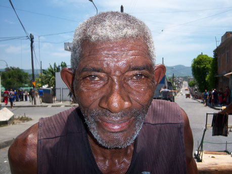 "Momoncillo vendor, Santiago de Cuba, in the ""pregonero""tradition of street vending."