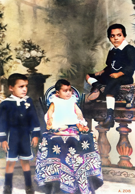 1899 : ( L - R ) Merwan, sister Freiny & brother Jamshed photographed in a Poona studio. Image colourized by Anthony Zois.