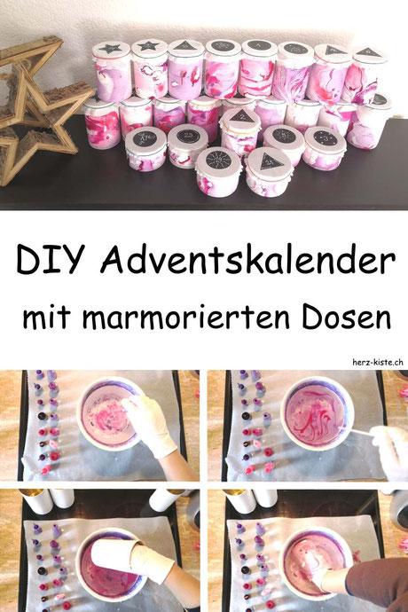 DIY Upcycling Adventskalender - eine Schritt für Schritt Anleitung wie du ganz einfach einen Adventskalender selber machen kannst. Dazu brauchst du marmorierte Dosen - welche du ganz einfach mit Nagellack marmorieren kannst.