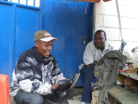 a shoeshiner in Tanzania