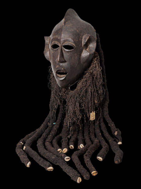 "Bamileke mask from ""ku n'gan"" society with human hair, cowries and golden plaque."