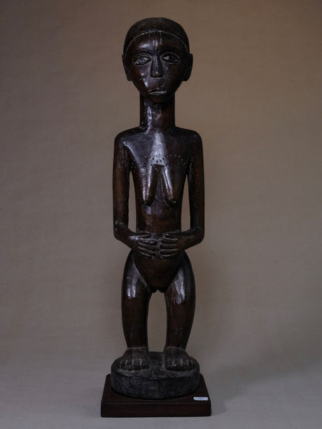 Bemba female figure with classical posture, dark brown wood and black head.